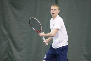 Andrey Goraychkov returns serve during a BYU home match. Photo by Jaren Wilkey/BYU