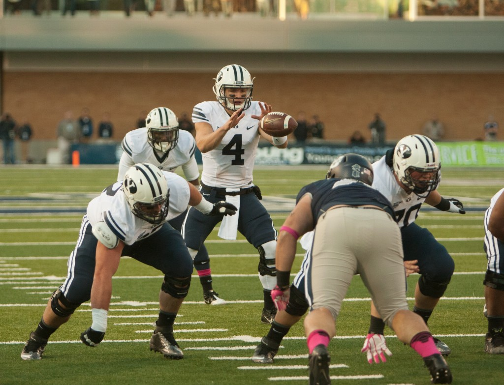 Taysom Hill gets the snap during the victory over Utah State. Photo by Ari Davis.