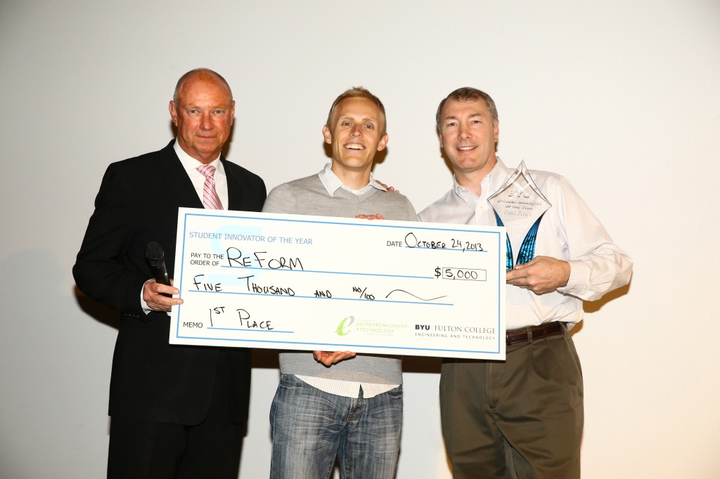 Myron Jones and Tom Peterson present the grand prize $5,000 award to Mark Nielson of Reform Building Systems for the 2013 Student Innovator of the Year Competition