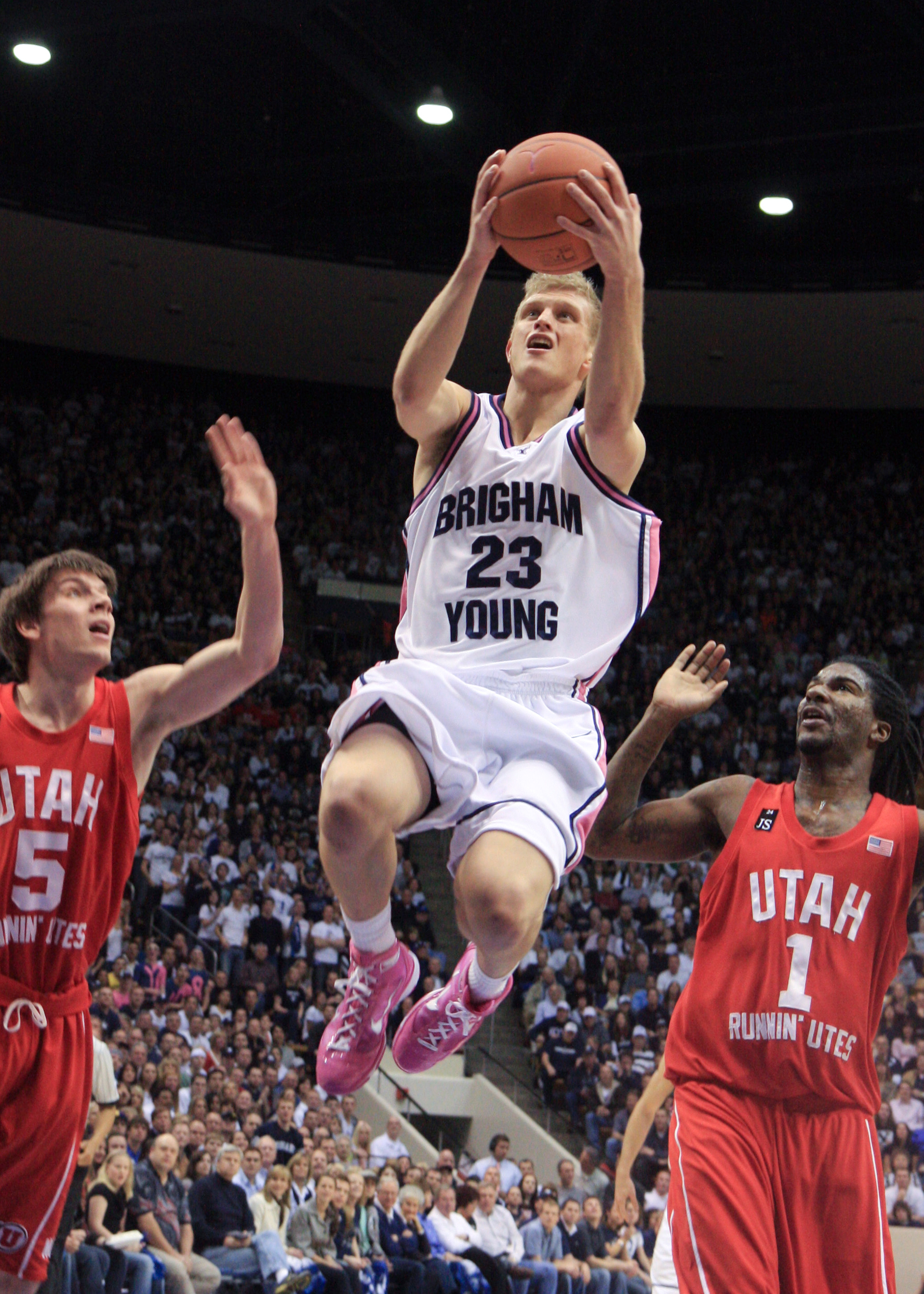 Tyler Haws weaves his way through the Utah defense to score a layup during last year's game. Photo by Natali Wyson.