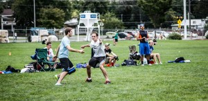 Nathan Craig makes a no-look pass in a tournament for the BYU ultimate frisbee team. Photo courtesy BYU Men's Ultimate.