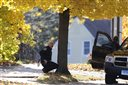 Police keep watch on the campus of Central Connecticut State University, Monday, Nov. 4, 2013, in New Britain, Conn. (AP Photo/Jessica Hill)