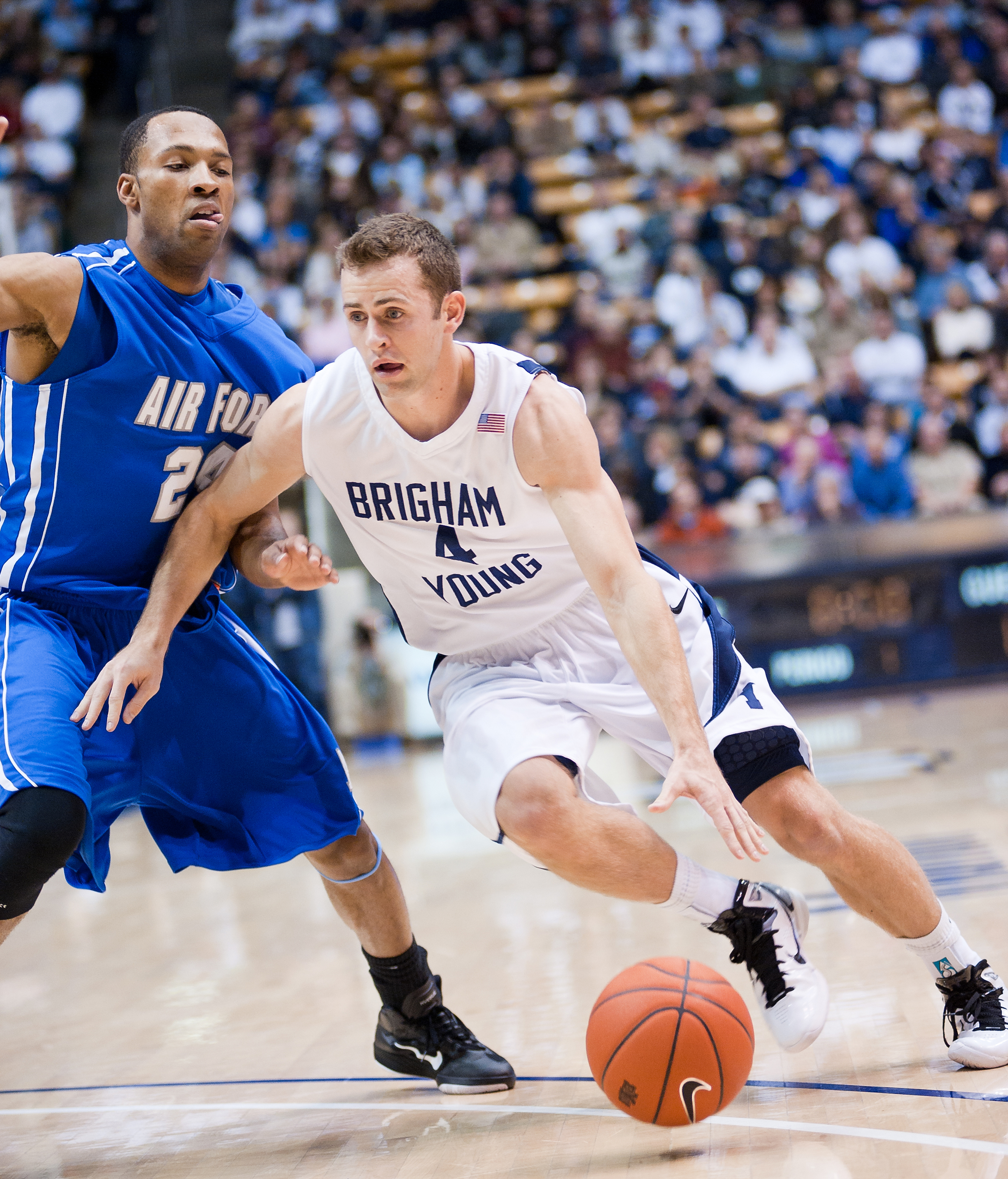 Jackson Emery dribbles past an Air Force defender in a game in 2011. BYU defeated Air Force 76-66. Photo by Chris Bunker.