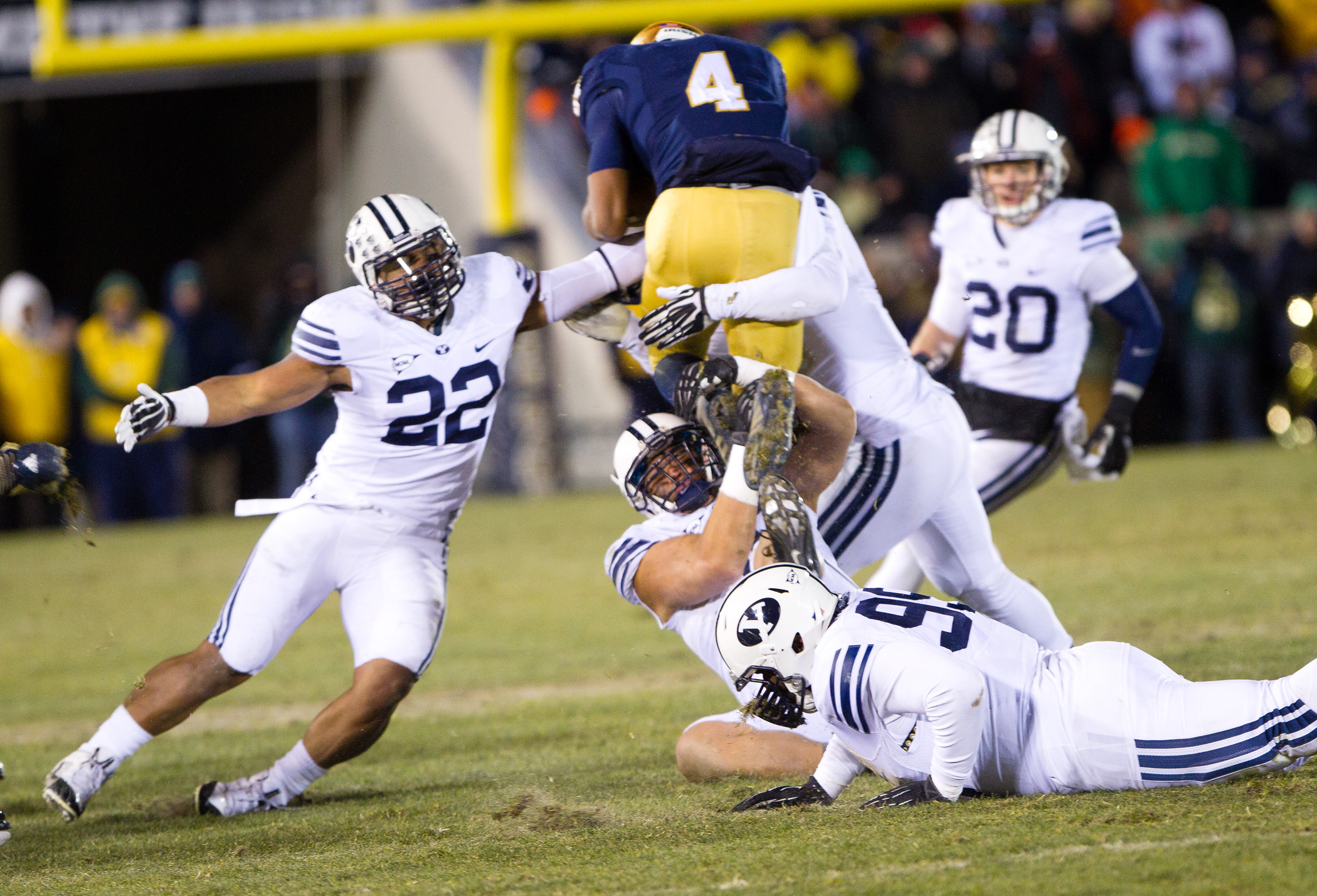 Manoa Pikula and two other BYU defenders take down a Notre Dame running back during Saturday's game in South Bend. (Sarah Hill)