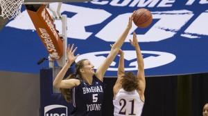 Jennifer Hamson swats a shot during a game. Photo by Meagan Larsen/ BYU Athletics