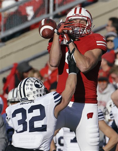 Brigham Young's Mike Hague (32) breaks up a pass intended for Wisconsin's Jordan Fredrick during the first half of an NCAA college football game on Saturday, Nov. 9, 2013, in Madison, Wis. AP Photo by Morry Gash
