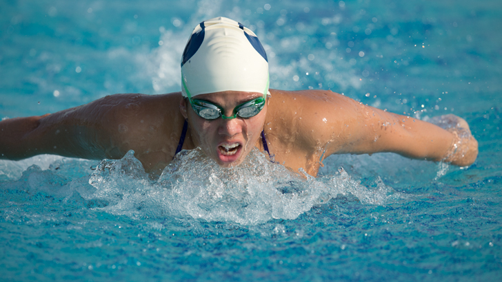 Senior Jessica Ampuero comes up for a breath during a swim meet earlier this season. Photo by Jaren Wilkey/ BYU Photo