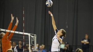 Kathryn Lecheminant spikes the ball over a Pepperdine defender. Lecheminant set a career high with 11 blocks and the Cougars prevailed in three sets. Photo courtesy Bella Torgerson/ BYU Photo