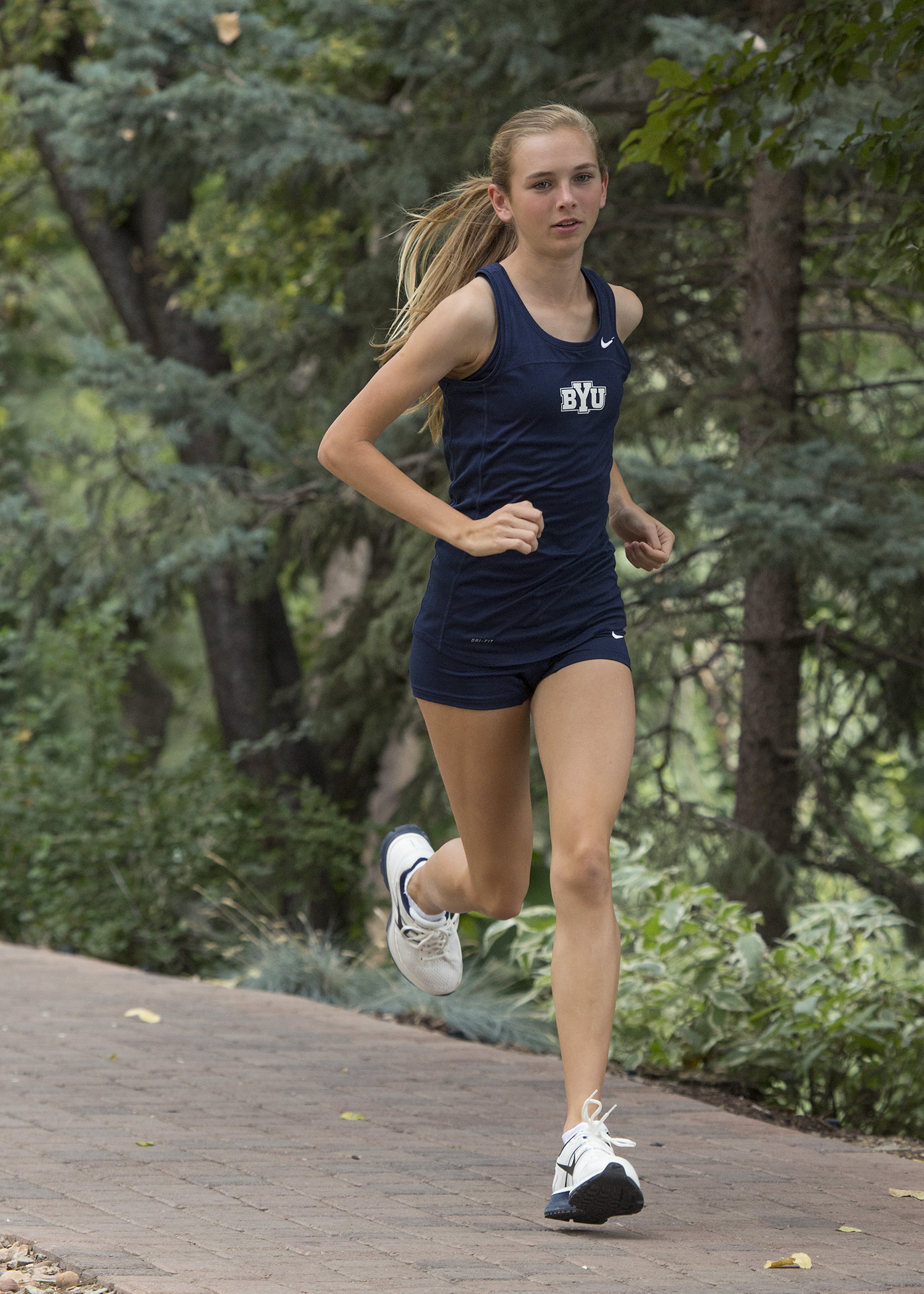 Danica Wyson runs at a cross-country meet during the 2012 season. Wyson is currently rehabilitating a shin injury, but has stayed involved with the team and plans to return in time for next season. Photo courtesy Mark Philbrick/ BYU Photo