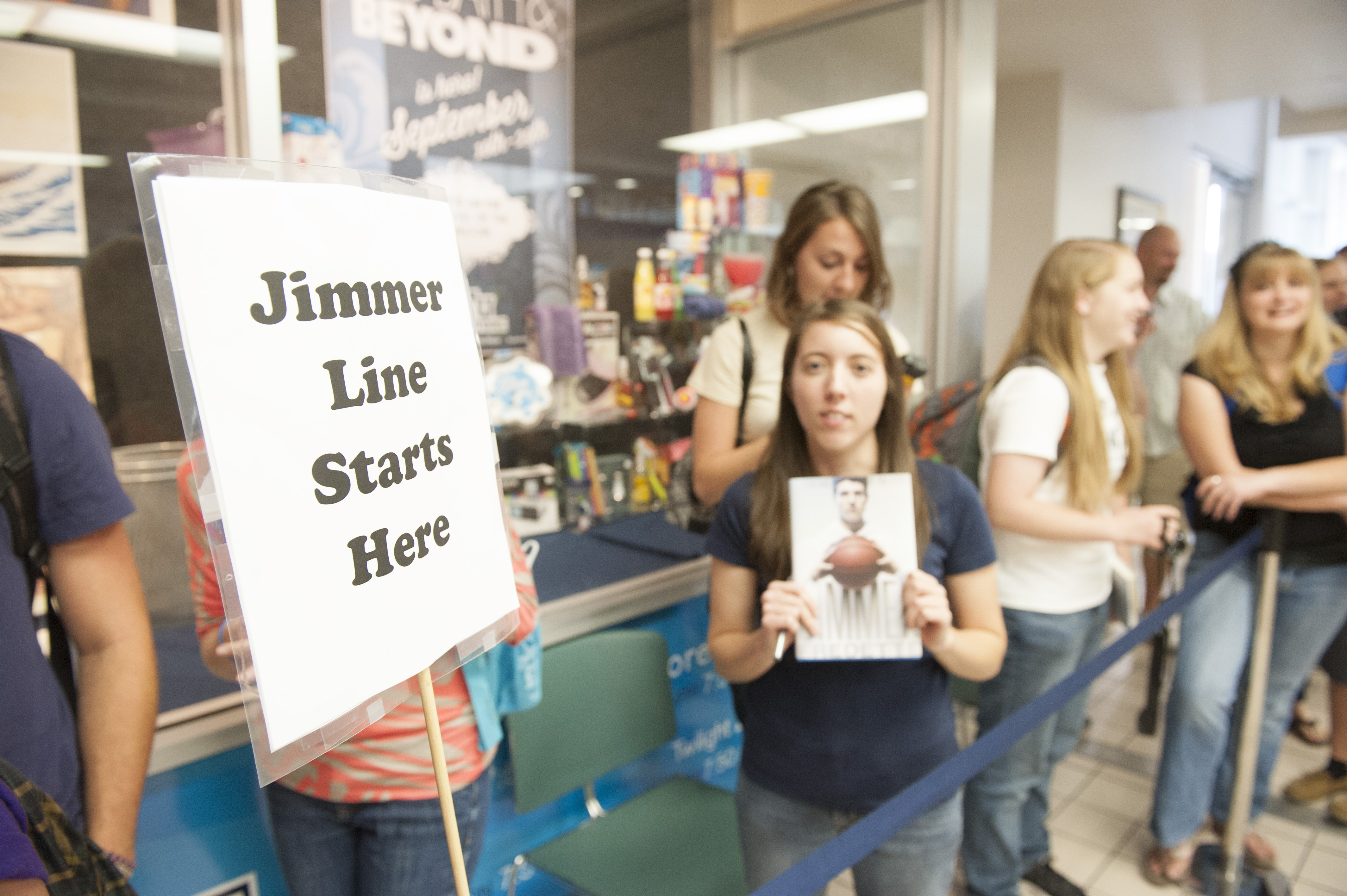 Students in line at the BYU Bookstore wait for Jimmer to autograph his book. Photo by Chris Bunker