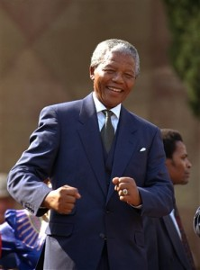 In this May 10, 1994, file photo, Nelson Mandela dances at a celebration concert in Pretoria, South Africa, following his inauguration as the country's first black president. Rev. Dr. Joan Brown recalled his humor during time she spent as an escort to Mandela in the United States. (Associated Press)