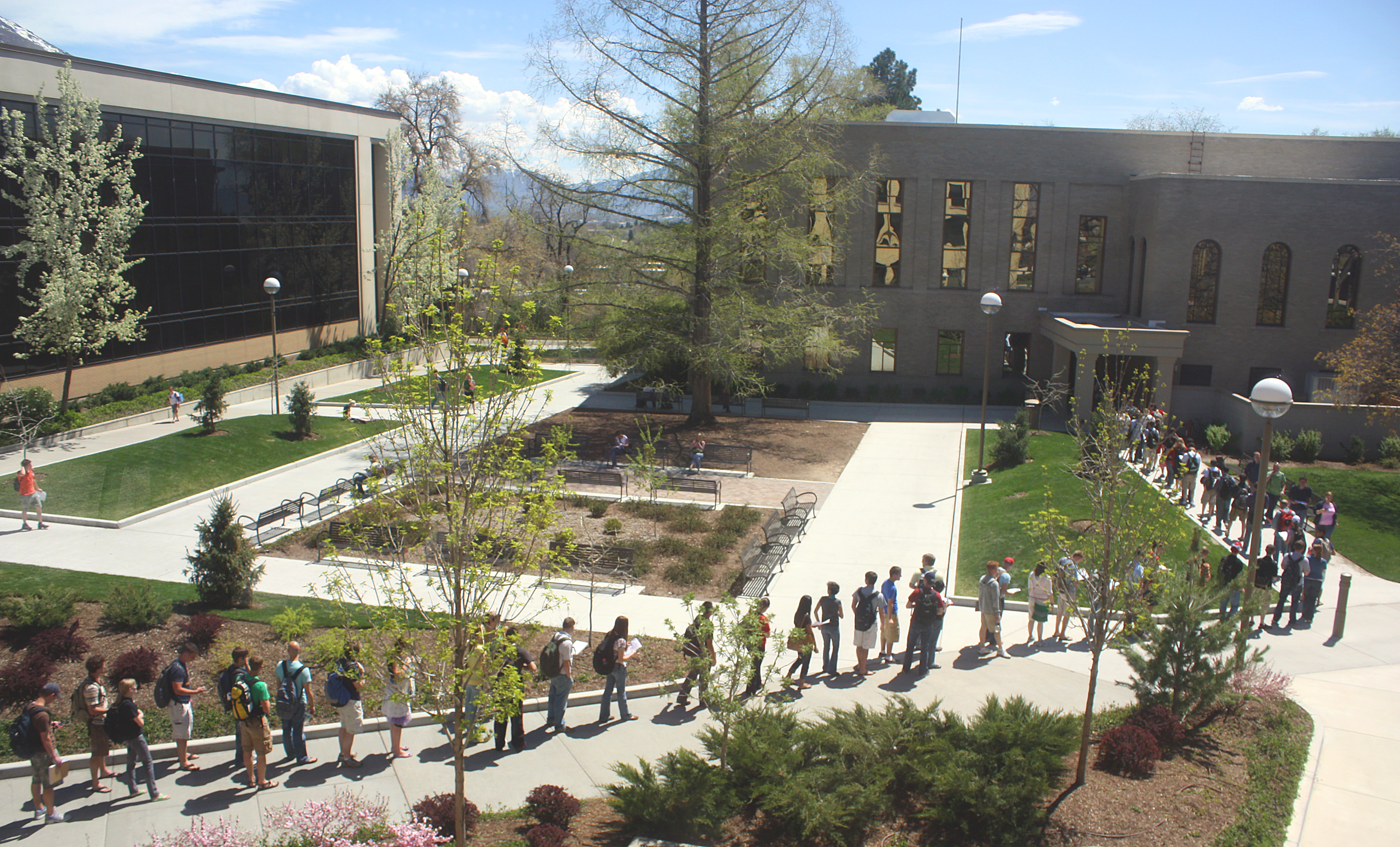 Students wait in long lines at the testing center--such sights may become more common because the fire marshall told the testing center to remove some of its desks. Photo by David Scott