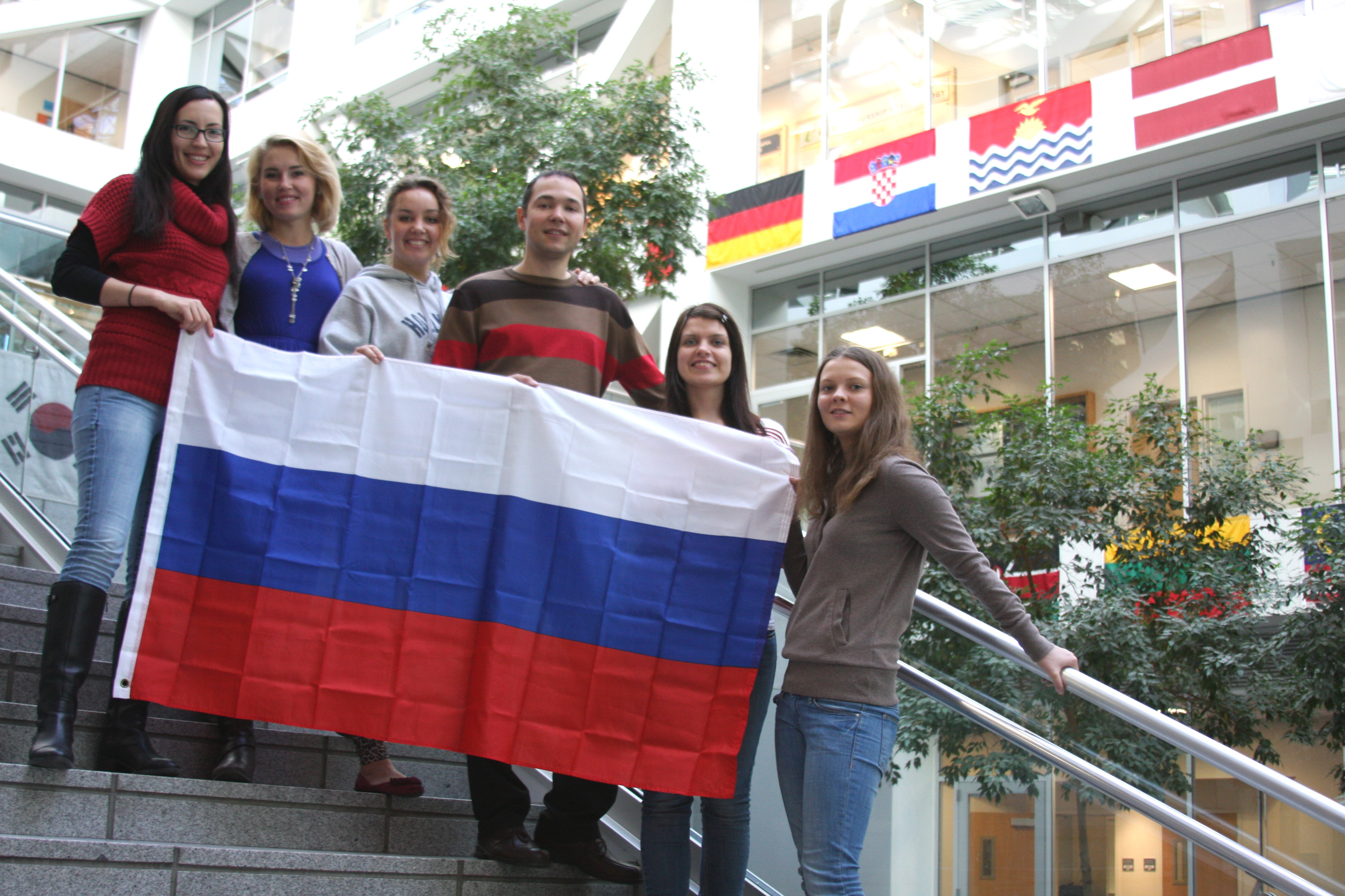 Left to right: Elena Sarokina, Polina Vasilevskaya, Elne Filatova, Viktor Arfanov, Tatiana Ignatova, Valentina Orlikhina. The Russian contingency of BYU students show off some extra Russia pride as the world's attention turns to the Sochi Olypics.  Photo by Natalie Stoker.