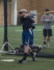 Former BYU baseball player Adam Law, who was drafted in the twelfth round of the 2013 Major League draft by the Los Angeles Dodgers, takes batting practice at BYU's Indoor Practice Field. Photo by Natalie Stoker