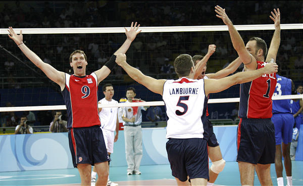 Former BYU players Ryan Miller (left) and Rich Lambourne (center) celebrate after a win during the 2008 Olympics in Beijing.