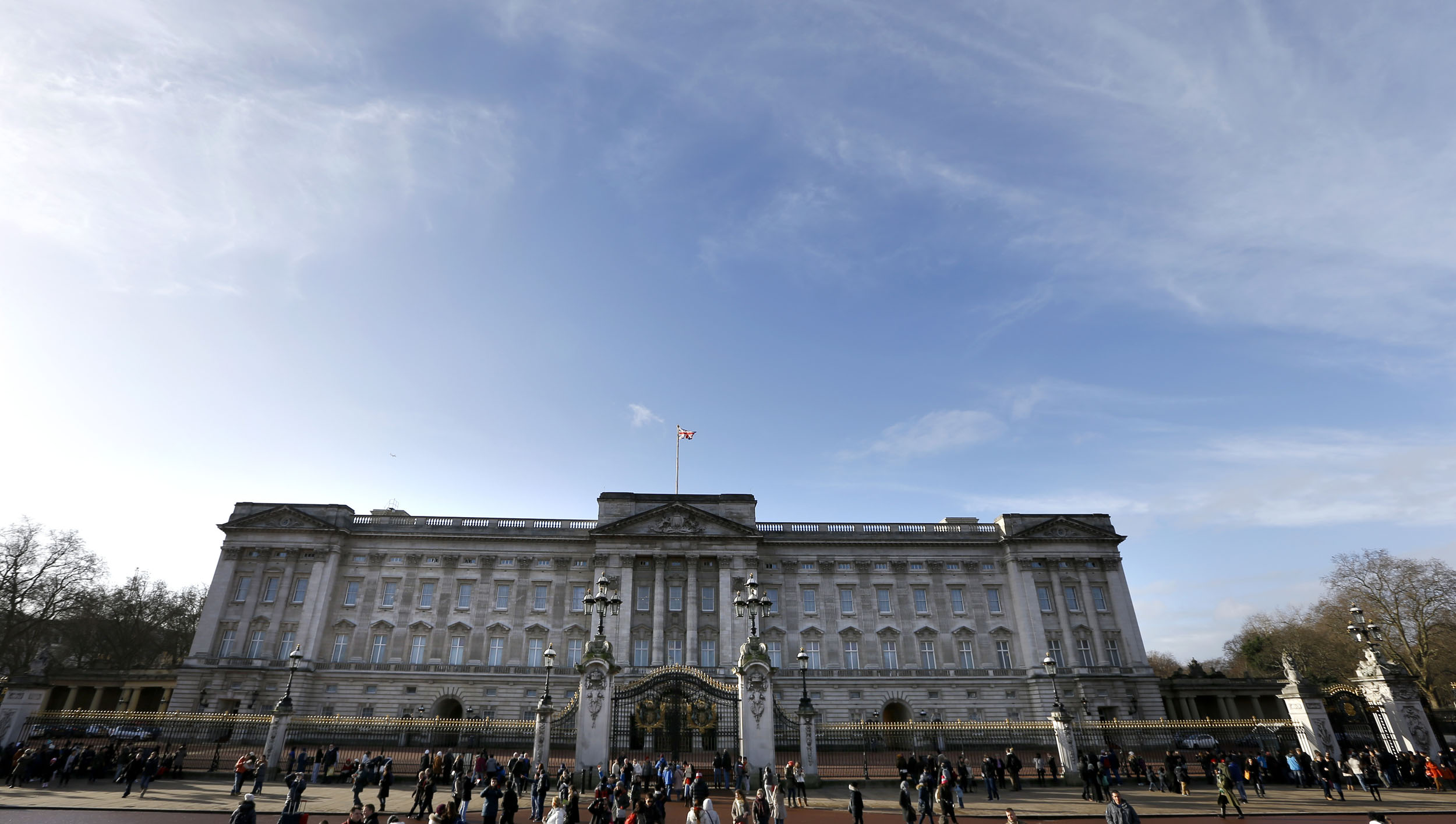 British lawmakers have criticized the financial affairs of Queen Elizabeth II and her household, urging the monarch to bring in more income by opening up Buckingham Palace to visitors more often. (Photo courtesy Associated Press)