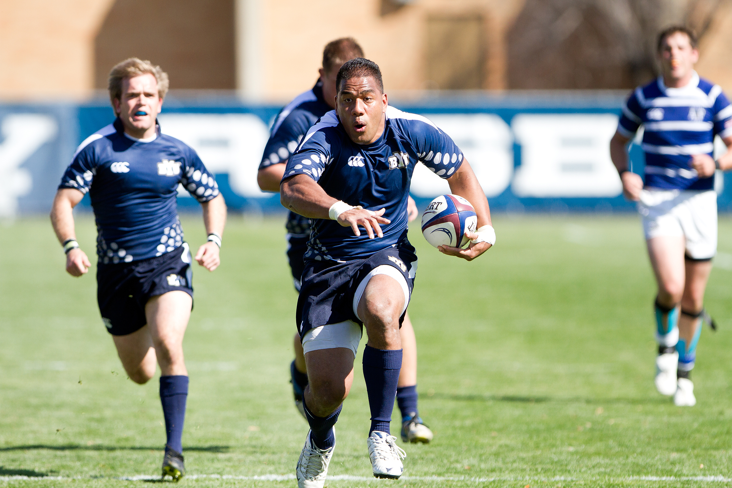 A BYU player runs for a try during a game at South Field against Air Force. Photo by Sarah Hill.
