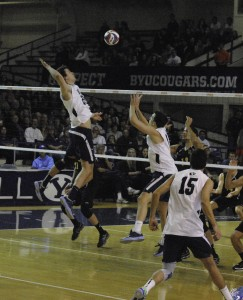 Taylor Sander jumps to spike the ball over the net in the win over Long Beach earlier this season. Photo by Maddi Dayton.