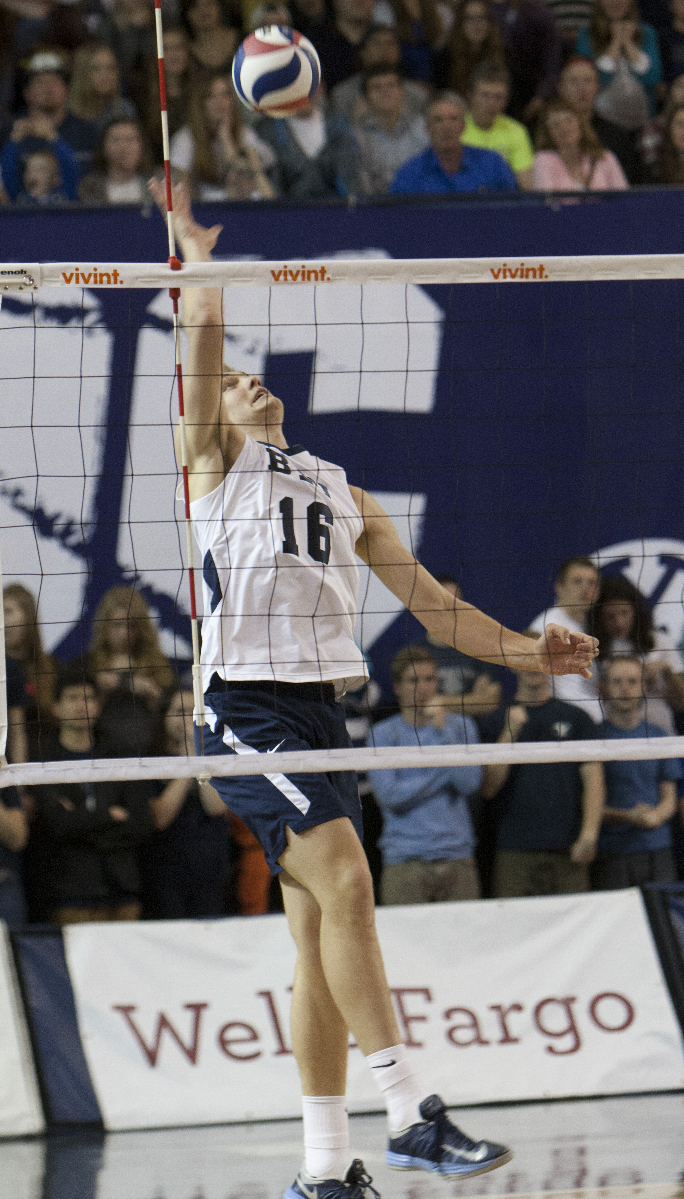 Tim Dobbert jumps to strike the ball over the net during the BYU vs. Pacific volleyball game earlier this season. Photo by Natalie Stoker