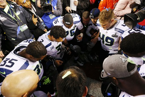 Members of the Seattle Seahawks pray after the NFL Super Bowl XLVIII football game against the Denver Broncos Sunday, Feb. 2, 2014, in East Rutherford, N.J. The Seahawks won 43-8. (AP Photo)
