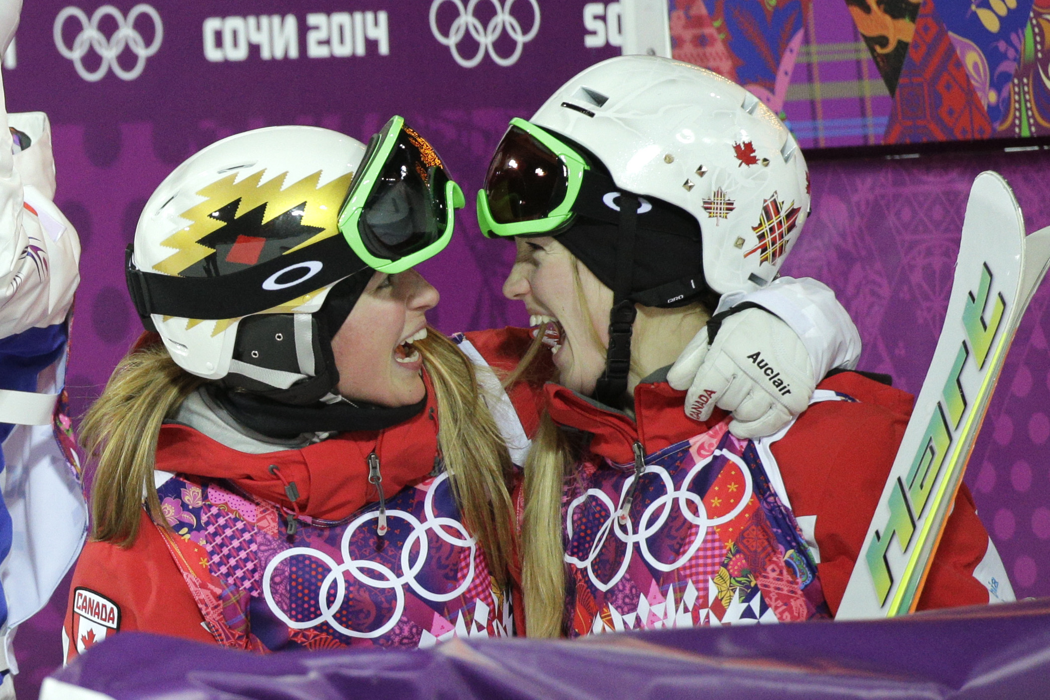 Canada's Justine Dufour-Lapointe, right, is congratulated by her sister, Chloe, after taking first place in the women's moguls final at the 2014 Winter Olympics, Saturday, Feb. 8, 2014, in Krasnaya Polyana, Russia. Justine won the gold medal and Chloe took the silver. (AP Photo/Jae C. Hong)