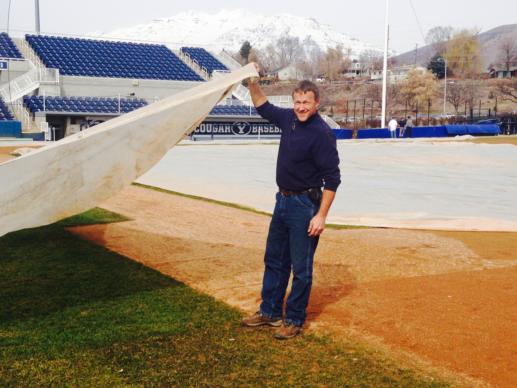 Brian Hill prepares the baseball field for the season. Photo by Madison Parks