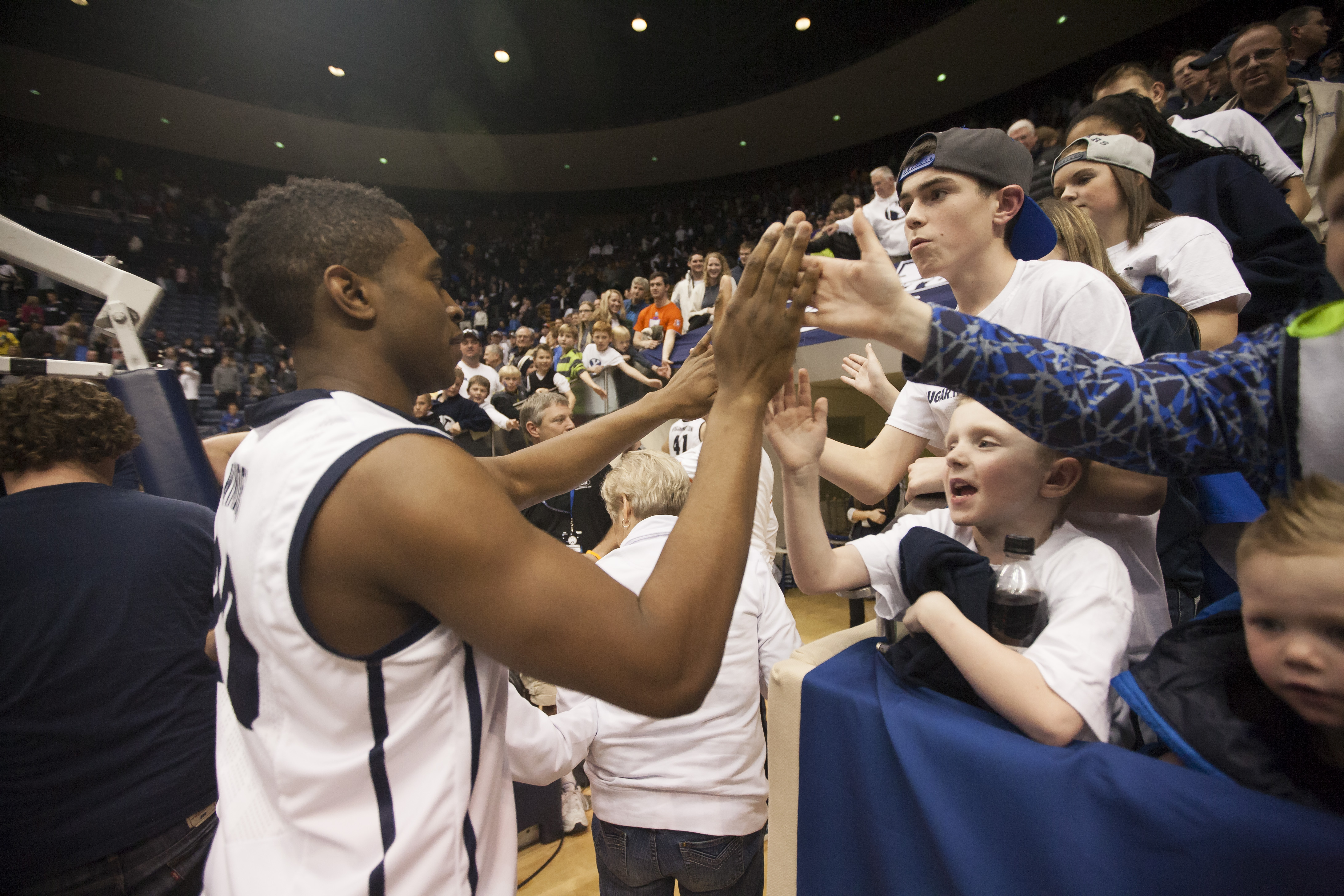Anson Winder gives high-fives to fans after a game against the Saint Mary's Gaels. Photo by Elliott Miller