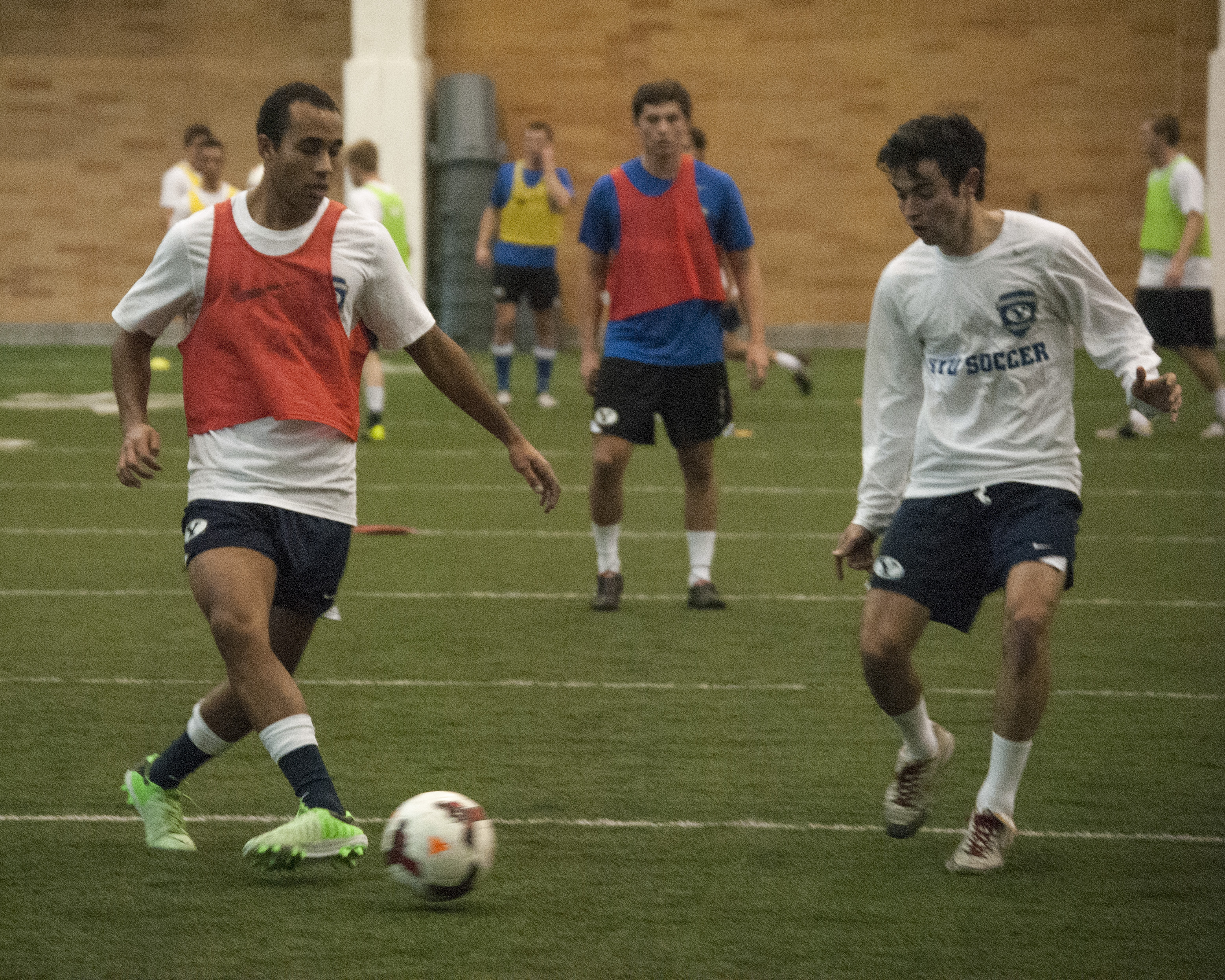 BYU Men's soccer players Junior Lartey (left) and Pedro Vasoncelos practice for their upcoming season. Photo by Maddi Dayton
