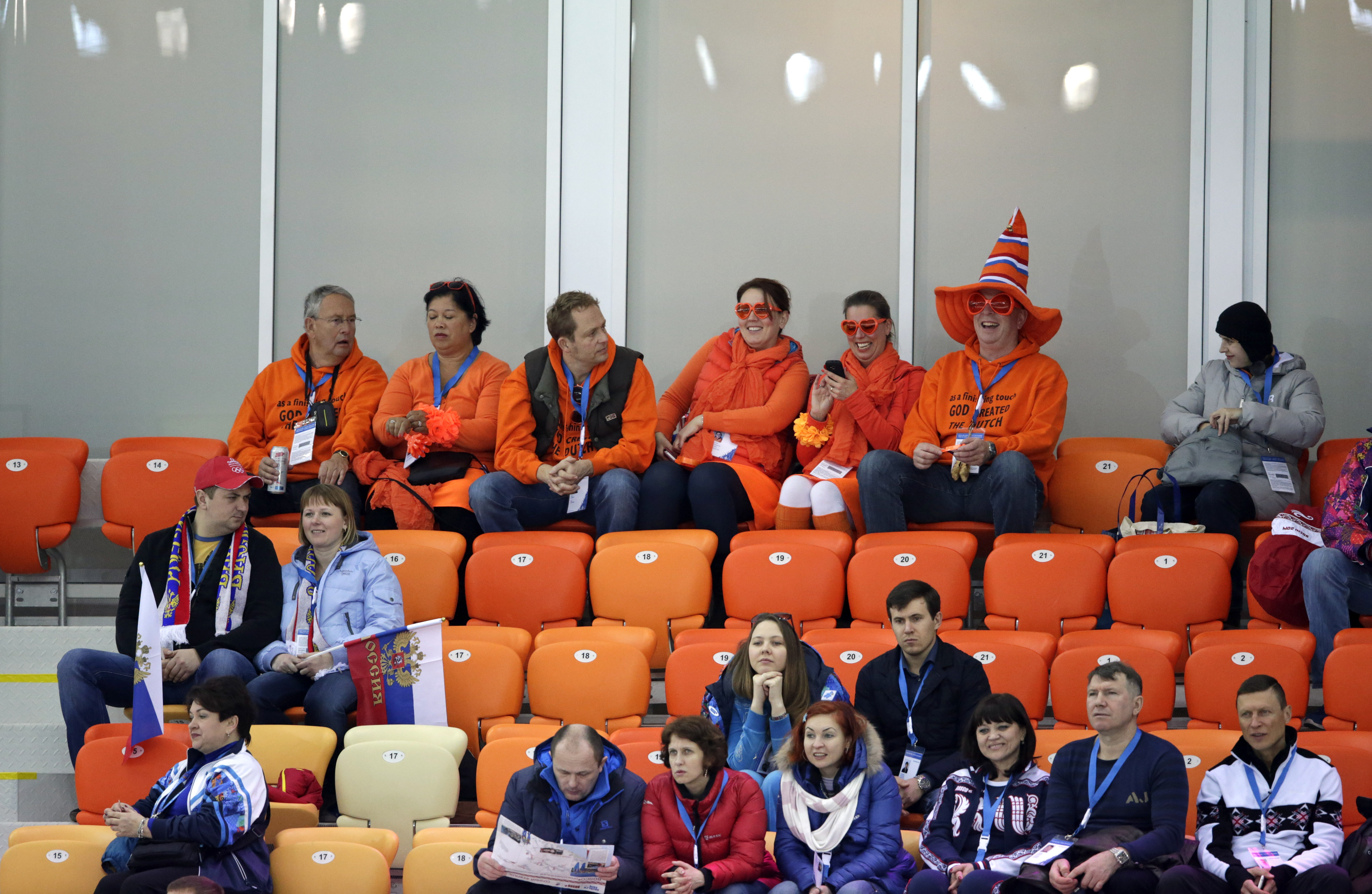 Empty seats are seen as Dutch skating fans wait for the start of the men's 5,000-meter speedskating race at the Adler Arena Skating Center at the 2014 Winter Olympics in Sochi, Russia, Saturday, Feb. 8, 2014. (AP Photo/Matt Dunham)