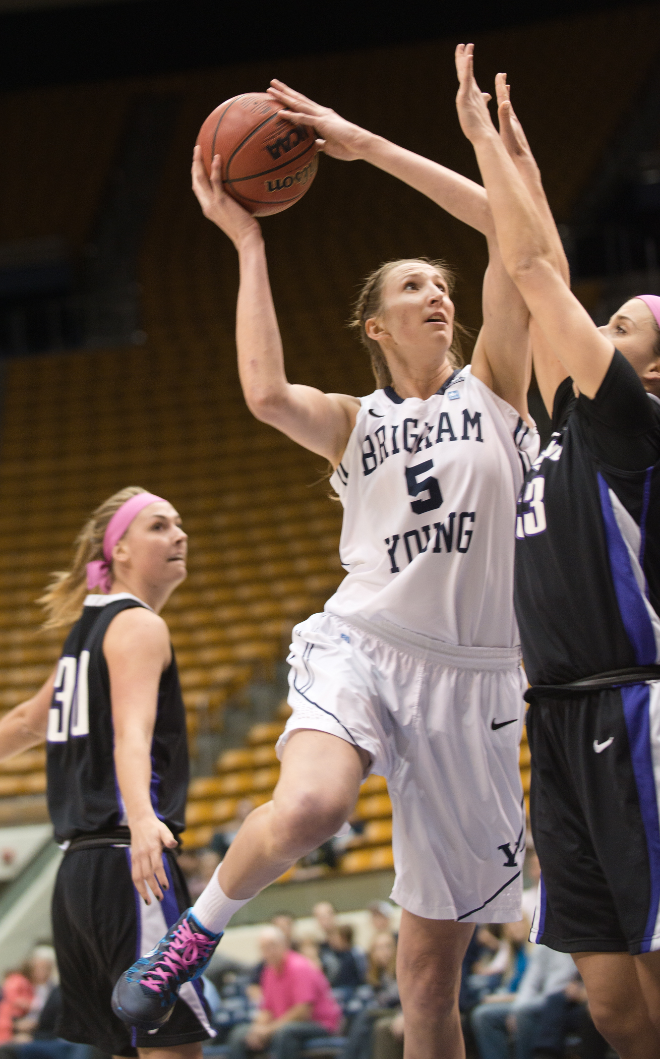 Jennifer Hamson drives to the basket against Portland during Thursday night's game in the Marriott Center. Photo by Sarah Hill.