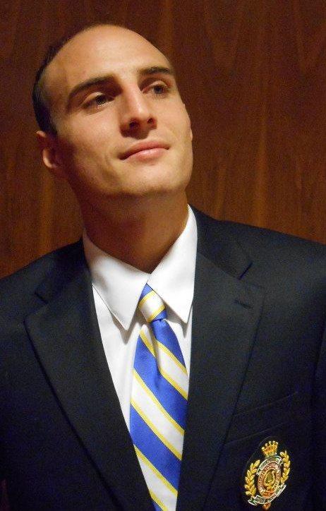 Rhett Fisher is shown in his BYU Men's Chorus uniform. Fisher died unexpectedly