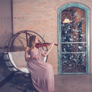 Josie Nielson's passion is playing the violin. She is currently working on a solo album that includes originals and classical music. Photo courtesy of Josie Winter.