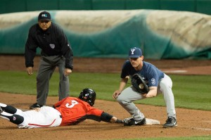 Brock Whitney tags a player as he tries to slide into first during a recent game. Photo by Ari Davis.