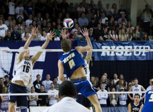 Taylor Sander leaps to block a shot from a UCSB player in the game at the Smith Fieldhouse Friday night. Photo by Samantha Williams.