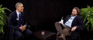 """This image from video released by Funny Or Die shows President Obama, left, with actor-comedian Zach Galifianakis during an appearance on """"Between Two Ferns,"""" the digital short with a laser focus on reaching people aged 18 to 34. (Photo courtesy Associated Press)"""
