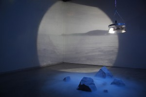 Sarah O Donnell, The Light is the Source of the Land, 2011. This piece features a rotating projectors that simulates the light of a lighthouse laminating the distant landscape. (Photo courtesy of the Museum of Art.)
