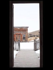 Sarah O Donnell, No Ghost, 2013. This video projection transports the viewer to the inside of a deserted building looking out on a ghost town. (Photo courtesy of the Museum of Art.)