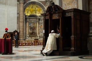 In this picture made available by the Vatican newspaper L' Osservatore Romano, Pope Francis is confessed by a priest in St. Peter's Basilica, at the Vatican, Friday, March 28, 2014 (Photo Courtesy Associated Press).