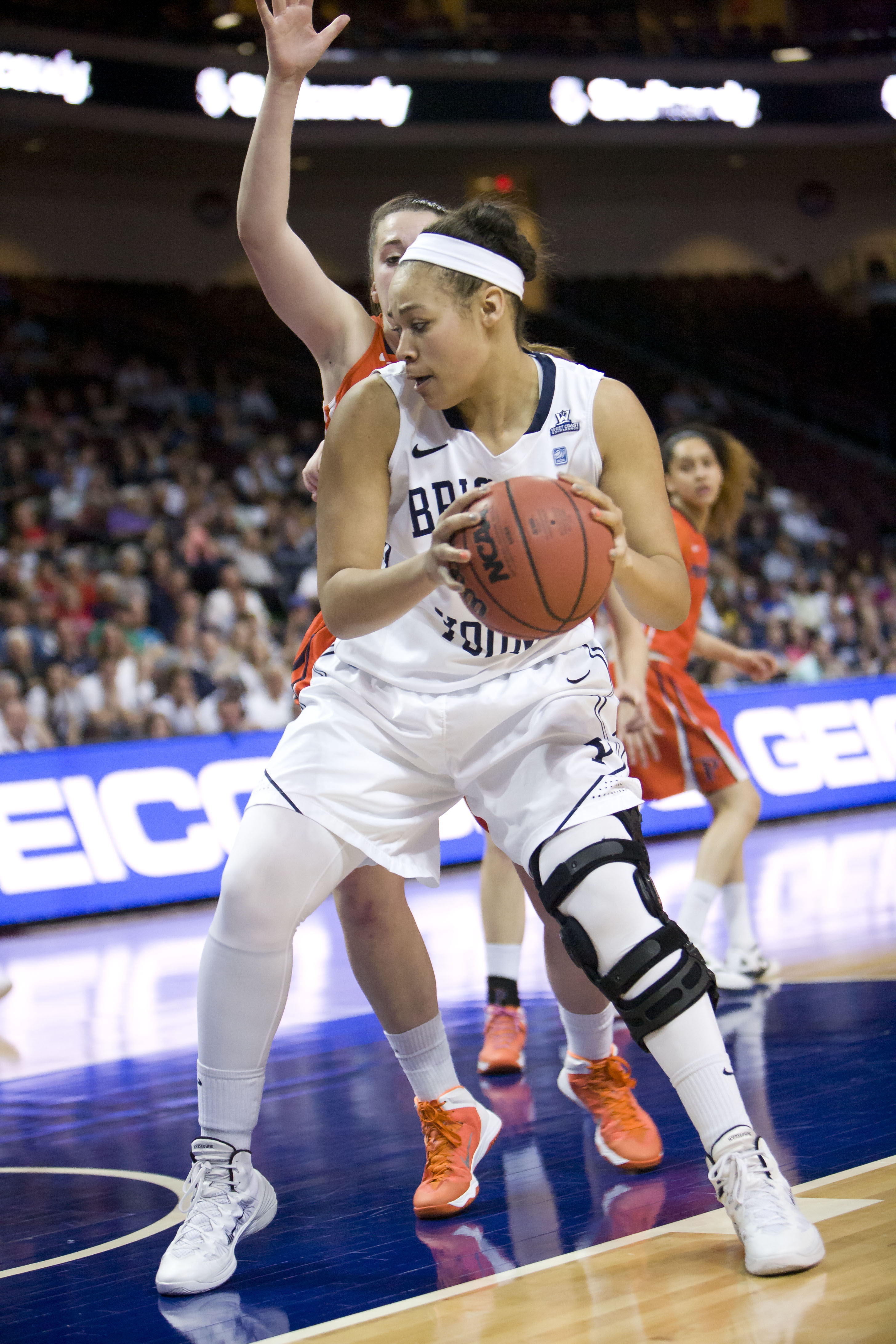 Morgan Bailey works around a Pepperdine player in Friday's WCC tournament game.