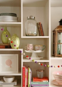 Strands of colorful felt balls adorn home shelves. These decorative balls will be sold by Hello Maypole, one of the many vendors to be featured at this year's Bijou Market. (Photo courtesy of Aubry Bennion.)