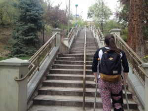 A student on crutches stands daunted at the base of the stairs on the south side of BYU campus. BYU is a campus that is hard to get to for disabled students. Photo by Taylor Winget