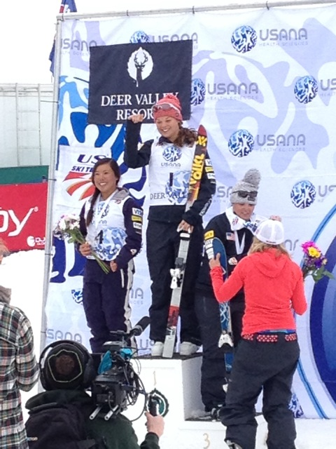 Ashley Caldwell accepts her first place finish at the U.S. Freestyle Championships. Si Ning, left, and Allison Lee, right, also made the podium. Photo by Sarah Ballard