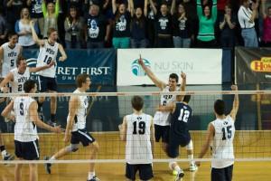 The BYU men's volleyball team rushes the court after Josue Rivera's game-winning serve against UC Irvine. Photo by Ari Davis