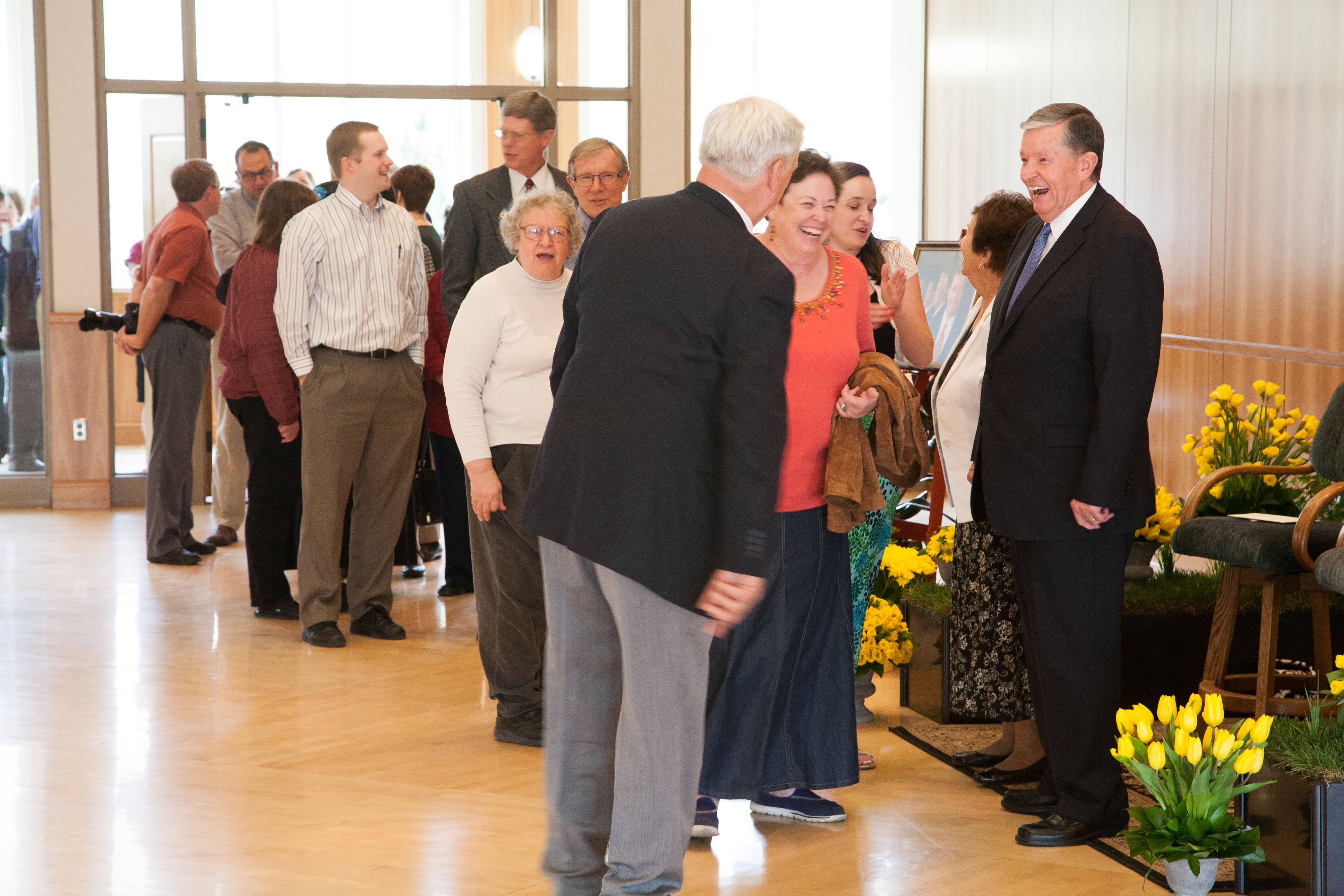 President and Sister Samuelson shake faculty's hands in a reception Wednesday evening. Photo by Elliott Miller.
