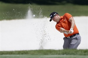 Daniel Summerhays hits a shot from the bunker during a practice round for The Players championship golf tournament. (AP Photo/John Raoux)