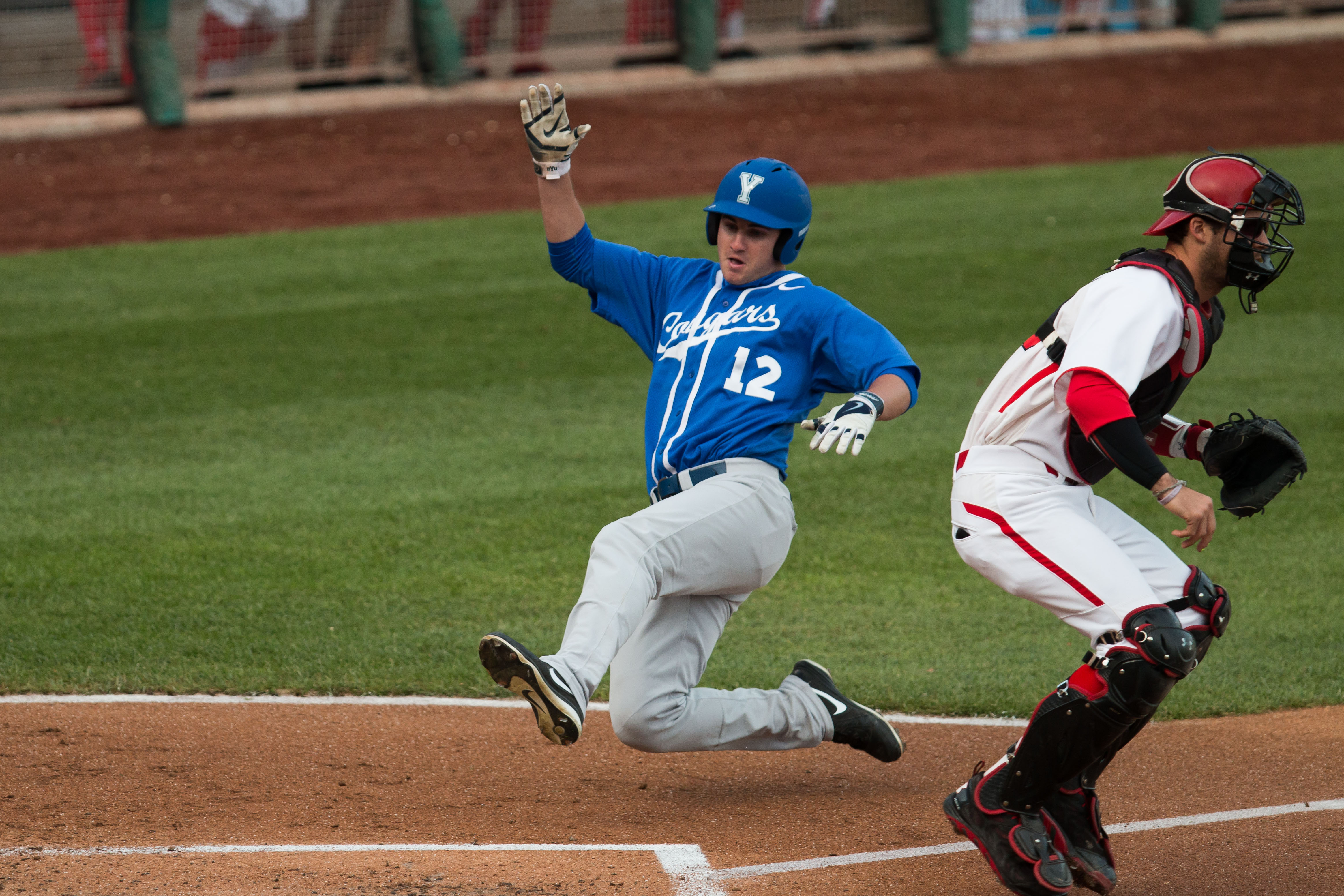 Kelton Caldwell slides into home plate during the game against Utah. Photo by Ari Davis