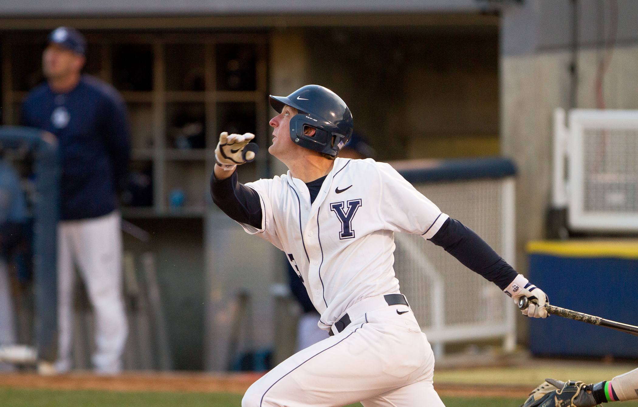 Brock Whitney follows through on a swing in a game against San Diego. Photo by Sarah Hill