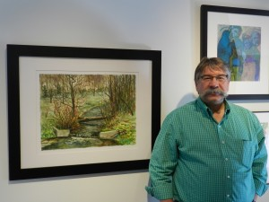 """Artist Blaine Clayton stands next to his painting, """"Farmington Brook,"""" which is featured in this years Spring Open Exhibition in the Attic at Academy Square. (Jeffrey Allen)"""