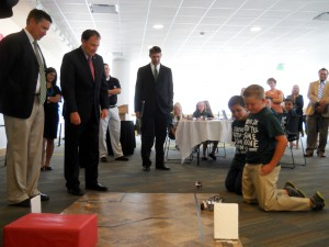 Orem Elementary students show Rep. Val Peterson (R-Orem), Gov. Gary Herbert and UVU President Matthew Holland the robot they built and programed. Photo by Matt McKinlay