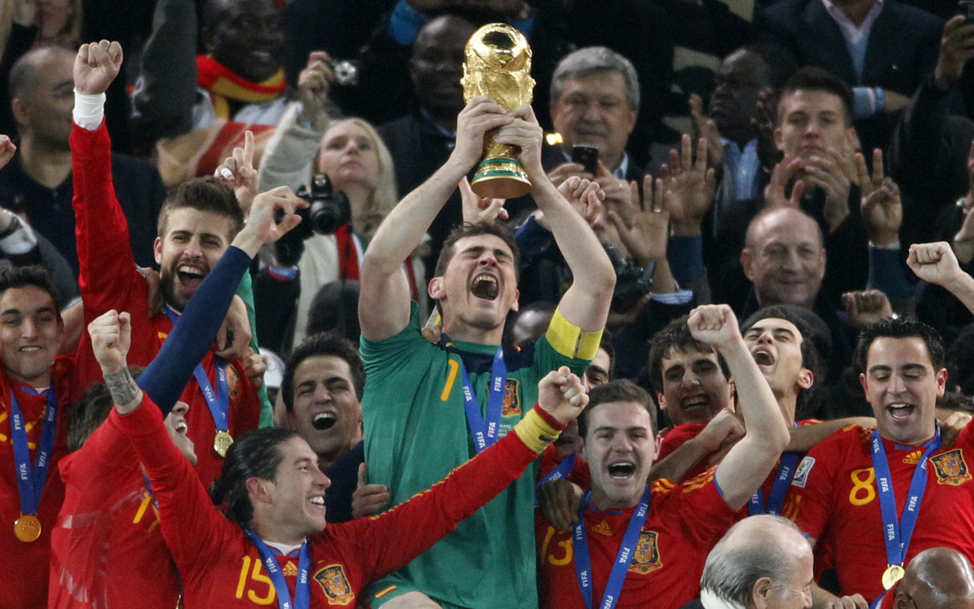 Spain goalkeeper Iker Casillas celebrates with his teammates after winning the 2010 World Cup against the Netherlands. (AP photo)